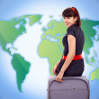 Young tourist woman with baggage on world map background - Stok fotoğraf