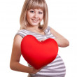 Stock Photo: Happy pregnant woman hold red heart in hands