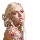 Portrait of beautiful girl with floral theme bodyart on white ba — Stock Photo