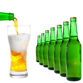 Bottle and glass with beer on white background — Stock Photo