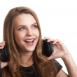 Attractive smiling woman with headphones on white background — Stock Photo