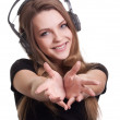 Stock Photo: Attractive smiling woman with headphones on white background