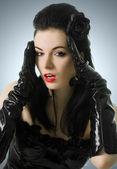 Ritratto di donna sexy corsetto nero e guanti — Foto Stock