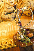 Arabic water pipe with tea set — Stock Photo