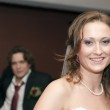 Smiling bride and groom behind her — Stock Photo
