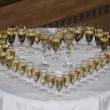 Heart made of champagne glasses - Stok fotoğraf
