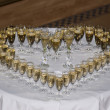 Heart made of champagne glasses - Stock Photo