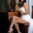Beatifull bride with antique phone - Stock Photo