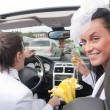Bride and groom in cabrio - Stock Photo