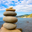 Balanced stones in sea beach — Stock Photo