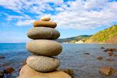 Balanced stones in sea beach — Stock Photo