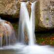 Stock Photo: Small waterfall in autumn forest