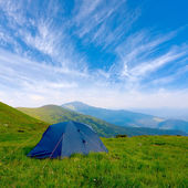 Tourists tent in mountain — Stock Photo