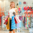 Happy girl after successful shopping — Stock Photo