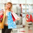 Happy girl after successful shopping — Stock Photo #4013861