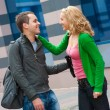 Stock Photo: Two attractive young met in the street