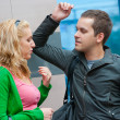 Young couple standing and talking — Stock Photo #4080240