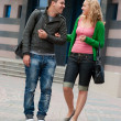 Young couple walking and talking — Stock Photo #4095365