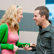 Young couple standing and talking - Stock Photo