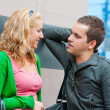 Young couple standing and talking — Stock Photo #4095374