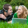 Young couple relax and listen to music - Stock Photo