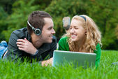 Young couple relax and listen to music — Stock Photo