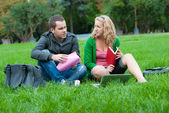 Two students relax and talking — Stock Photo