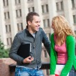 Two attractive happy students - Stockfoto
