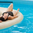 Stock Photo: Young beautiful woman resting near pool
