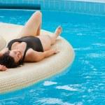 Young beautiful woman resting near pool — Stock Photo