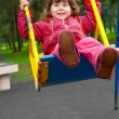 Girl swinging on a swing — Stock Photo #4379595
