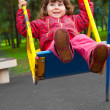 Girl swinging on a swing — Stock Photo