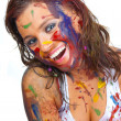 Stock Photo: Happy gir smeared in paint