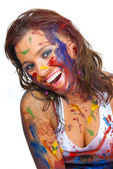 Happy gir smeared in paint — Stock Photo