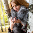 Portrait of a girl with a fur collar — Stock Photo