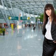 Young business woman in airport — Stock Photo