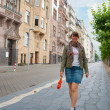 Young girl walking down the street — Stock Photo