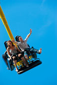 Couple riding on the attraction — Stock Photo