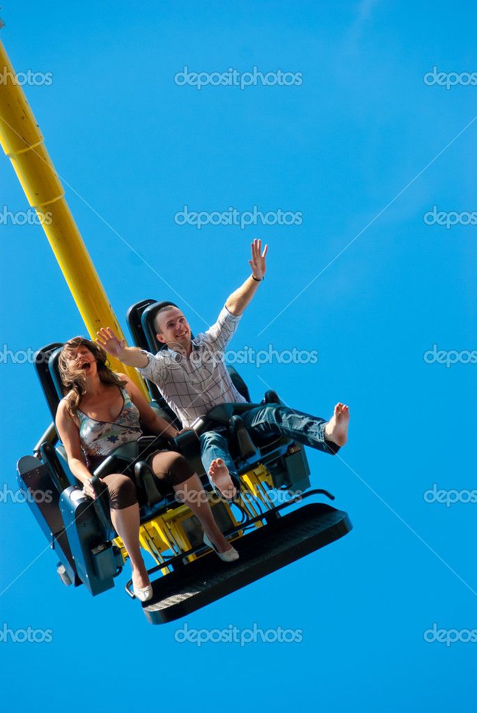 Happy young couple riding on the attraction  Stock Photo #4633430