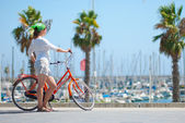 Young girl with a bicycle — Stock Photo