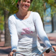 A young woman rides a bicycle — Stock Photo