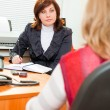 Stock Photo: Businesswominterviewing candidate
