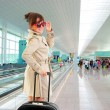 Stock Photo: Young woman at the international airport