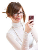 Girl looks into mobile phone — Stock Photo