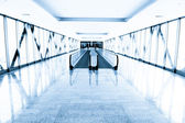 Blue glass corridor in office centre — Stock Photo