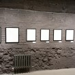 Empty frames on the brick wall - Stock Photo