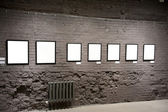 Empty frames on the brick wall — Stock Photo