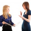 Two young business women discussing documents — Stock Photo #5303359