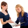 Two young business women discussing documents — Stock Photo #5303361
