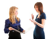 Two young business women discussing documents — Stock Photo